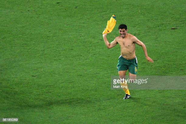 John Aloisi of Australia celebrates victory in the penalty shootout during the second leg of the 2006 FIFA World Cup qualifying match between...