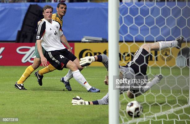 John Aloisi of Australia scores the 4th goal aginst Robert Huth and Oliver Kahn of Germany during the FIFA Confederations Cup 2005 match between...
