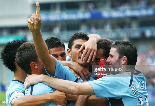 John Aloisi of Sydney celebrates his goal with team mates during the round 27 ALeague match between Sydney FC and the Melbourne Victory at Sydney...