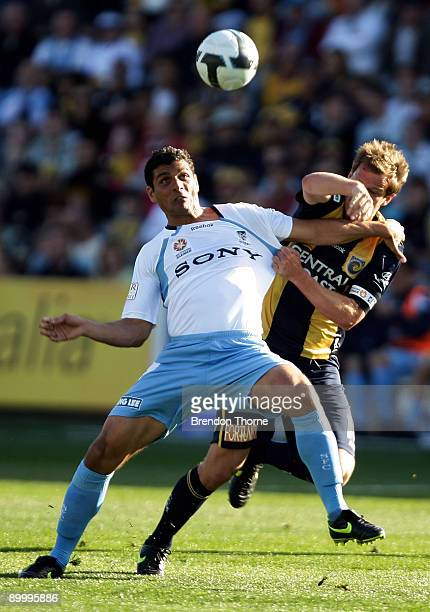 John Aloisi of Sydney competes with Alex Wilkinson of the Mariners during the round three A-League match between the Central Coast Mariners and...