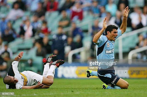 John Aloisi of Sydney is brought down by Emmanuel Muscat of the Phoenix during the round 13 ALeague match between Sydney FC and the Wellington...
