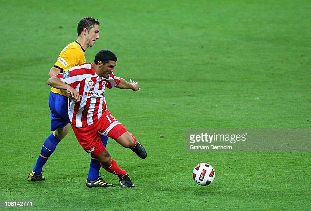 John Aloisi of the Heart looks to control the ball under pressure during the round 23 ALeague match between the Melbourne Heart and Gold Coast United...