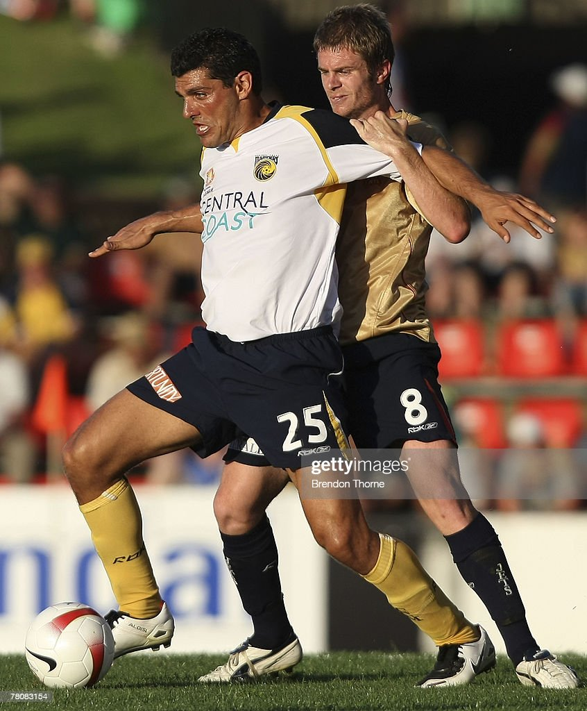 John Aloisi of the Mariners competes with Matt Thompson of the Jets during the round 14 A-League match between the Newcastle Jets and the Central Coast Mariners at EnergyAustralia Stadium on November 25, 2007 in Newcastle, Australia.