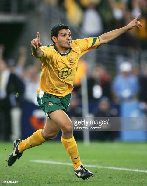 John Aloisi of the Socceroos celebrates scoring the winning goal in the penalty shootout during the second leg of the 2006 FIFA World Cup qualifying...