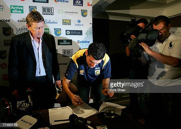 John Aloisi signs his new contract in front of Central Coast Mariners Executive Chairman Lyall Gorman at a press conference at the Marriot Hotel on...
