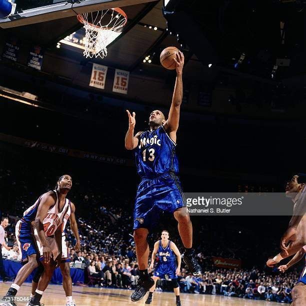 John Amaechi of the Orlando Magic shoots a layup against Kurt Thomas of the New York Knicks during a game played in 2001 at Madison Square Garden in...
