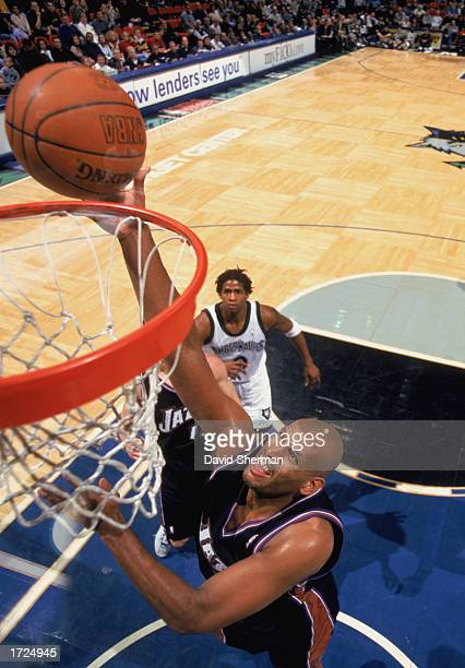 John Amaechi of the Utah Jazz makes a dunk during the NBA game against the Minnesota Timberwolves at Target Center on January 4 2003 in Minneapolis...