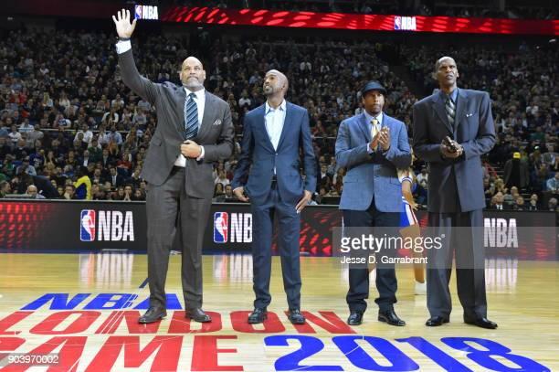 John Amaechi Richard Hamilton Andre Miller and Robert Parish are seen during the game between the Philadelphia 76ers and Boston Celtics on January 11...