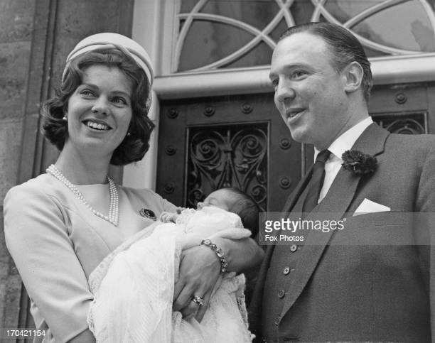 John Ambler with Princess Margaretha of Sweden holding their three week old daughter Sybilla Louise Ambler after Sybilla's christening at St Pauls'...
