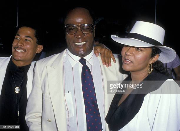 John Amos wife Noel Amos and son Kelly Amos attend the premiere of 'Coming To America' on June 26 1988 at Mann Chinese Theater in Hollywood California