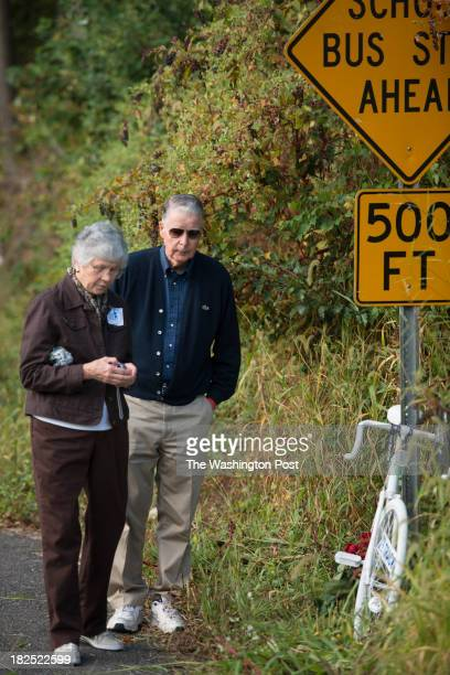 John and Carolyn Naughton observe the ghost bike placed in honor of their daughter Trish Cunningham who was killed lat month Bicyclists join Rally...