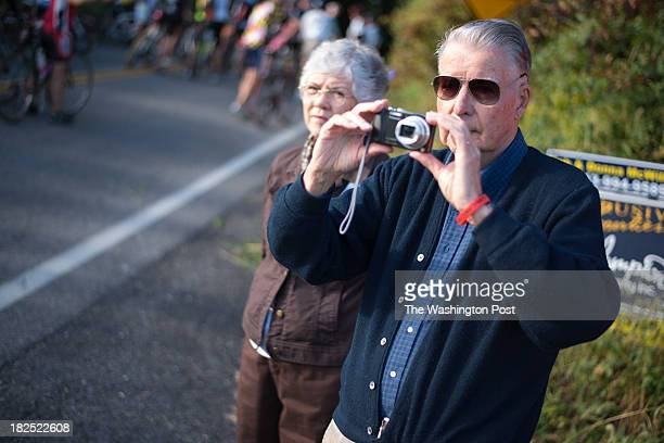 John and Carolyn Naughton observe the many bicyclists that came to pay tribute to their daughter Trish Cunningham who was killed lat month Bicyclists...