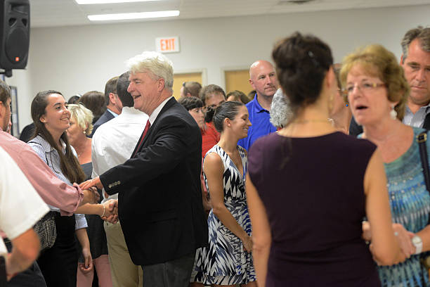 Photos et images de memorial service held for photojournalist james john 2nd l and diane foley 2nd r greet people following a m4hsunfo