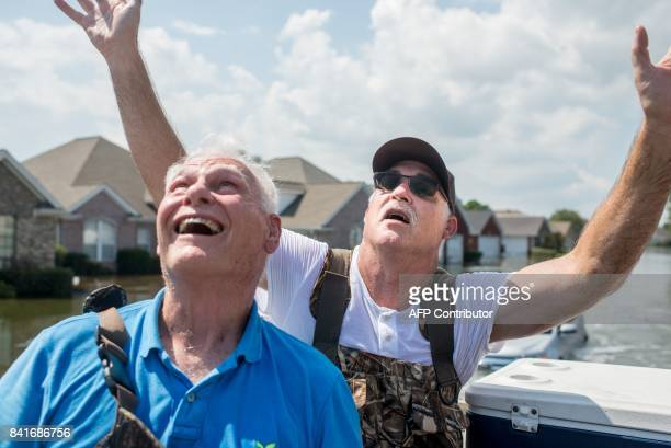 John and Doug Lablanc yell up at rescue planes in Port Arthur Texas on Thursday September 1 2017 Stormweary residents of Houston and other Texas...