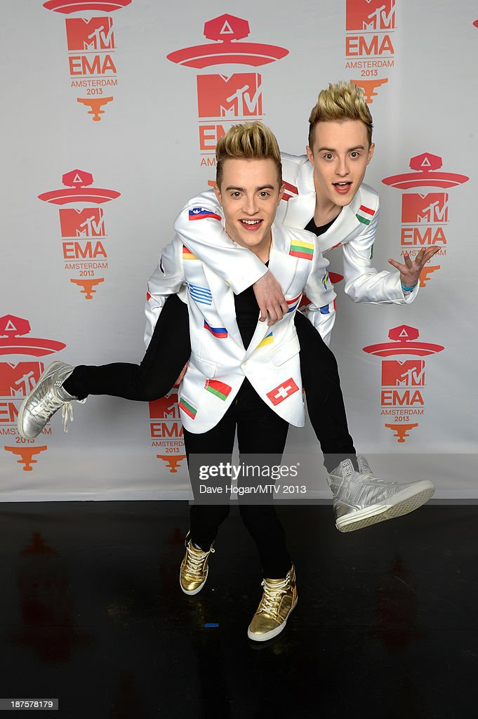 John and Edward Grimes of Jedward pose in the Exclusive Arrivals Studio during MTV EMA's 2013 at the Ziggo Dome on November 10, 2013 in Amsterdam, Netherlands.