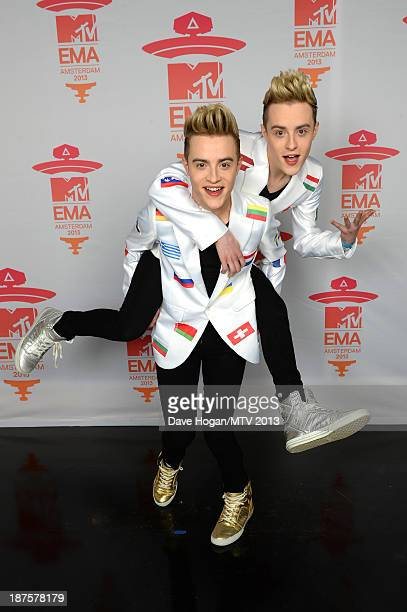 John and Edward Grimes of Jedward pose in the Exclusive Arrivals Studio during MTV EMA's 2013 at the Ziggo Dome on November 10 2013 in Amsterdam...
