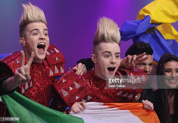John and Edward Grimes of the band Jedward from Ireland celebrate after qualifying for the finals after the second semifinals of the Eurovision Song...