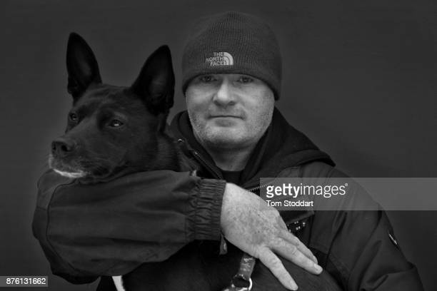 John and his dog Rosie pose for a picture on October 31 2017 in Newcastle upon Tyne England John says 'Ill soon be going on Universal Credit and it's...