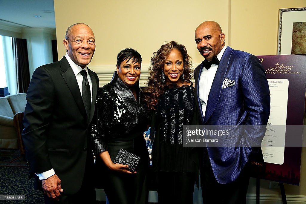 John and his wife Vicki Palmer and Marjorie and Steve Harvey attend the 2014 Steve & Marjorie Harvey Foundation Gala presented by Coca-Cola VIP Reception at the Hilton Chicago on May 3, 2014 in Chicago, Illinois.