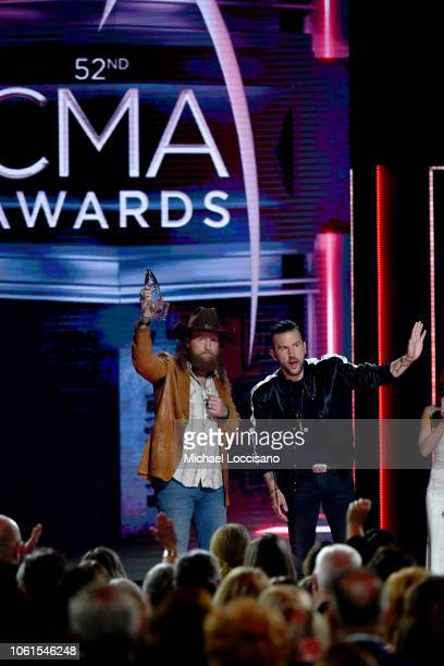 John and JT Osborne of the Brothers Osborne accept the Vocal Duo of the Year Award onstage during the 52nd annual CMA Awards at the Bridgestone Arena...
