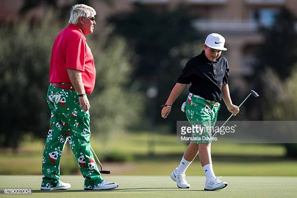 John and Little John Daly get ready to putt on the 17th green during the first round of the PNC Father/Son Challenge at The RitzCarlton Golf Club on...