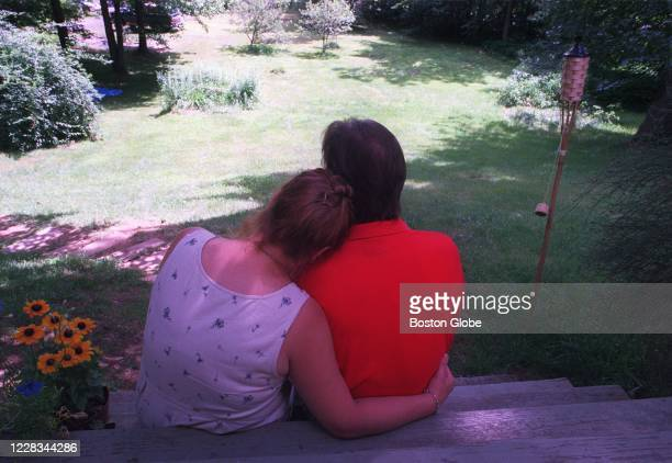 John and Maggie Bish sit on their front porch in Warren MA on July 20 2000 after talking about all the love and support they have received as a...