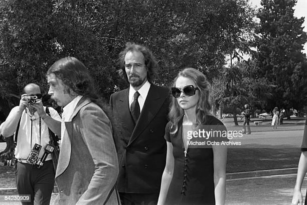 John and Michelle Phillips attend the funeral for singer Cass Elliot of The Mamas And The Papas at Groman Mortuary on August 2 1974 in Los Angeles...