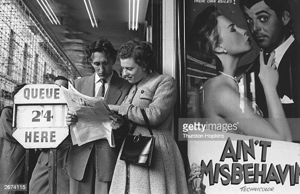 John and Sheila Phillips of Lambeth, south London, choose which film to see on a night out in London's West End. They have a budget of twenty...