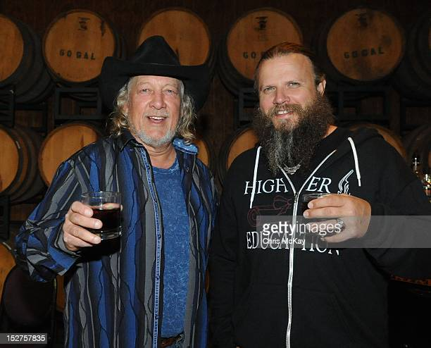 John Anderson and Jamey Johnson attend the concert following the 2012 Colt Ford Friends Celebrity Golf Classic at Legends Golf Course Club on...