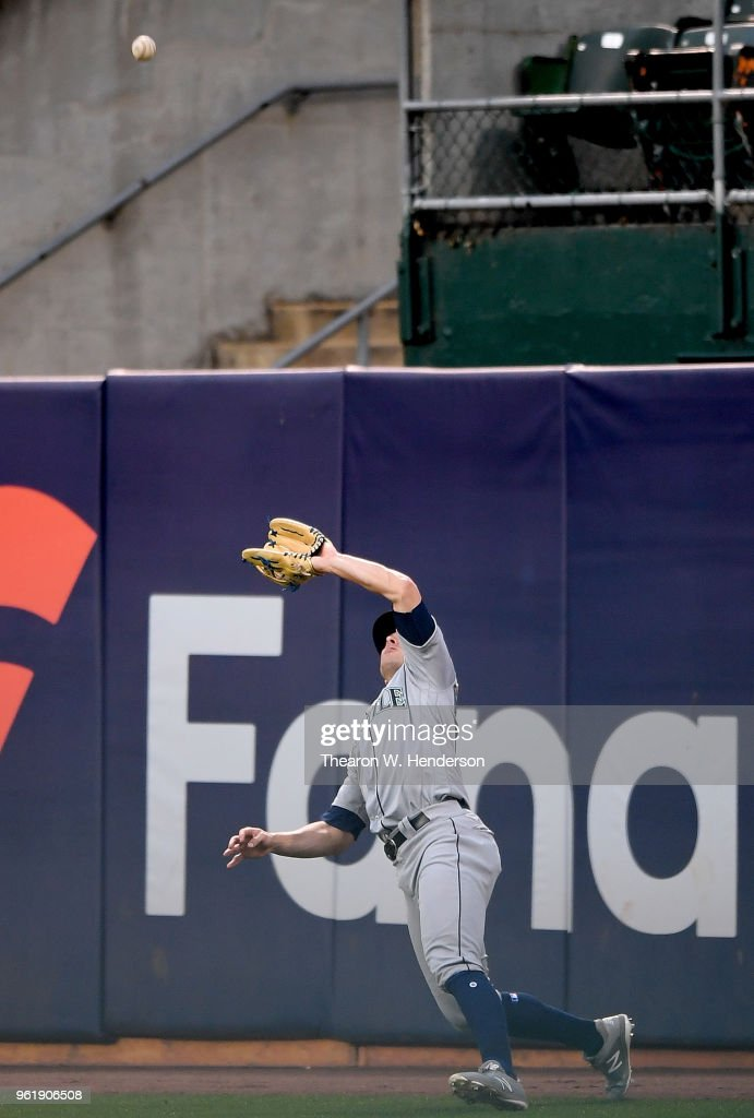 John Andreoli #57 of the Seattle Mariners, in his major league debut, makes an off balance catch in right field against the Oakland Athletics in the bottom of the third inning at Oakland Alameda Coliseum on May 23, 2018 in Oakland, California.