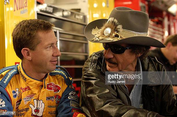 John Andretti driver of the Cherrios Dodge Intrepid chats with Richard Petty during practice for the Coca Cola 600 on May 24 2003 at Lowes Motor...