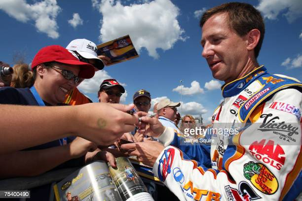 John Andretti driver of the National Tire Battery Dodge signs autographs for fans during qualifying for the NASCAR Nextel Cup Series USG Sheetrock...