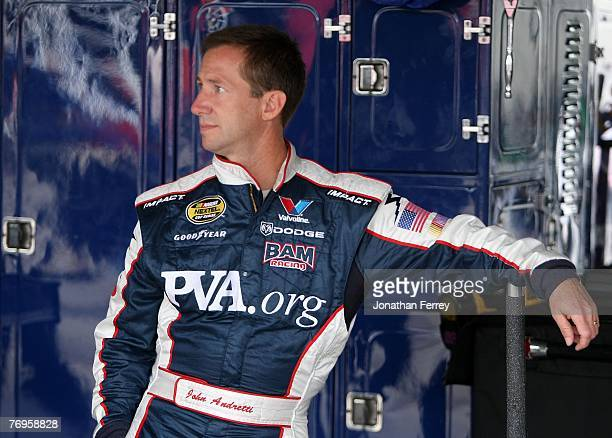 John Andretti driver of the Paralyzed Veterans of America Dodge waits in the garage prior to practice for the NASCAR Nextel Cup Series Dodge Dealers...