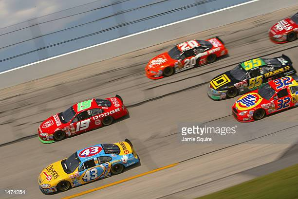John Andretti driver of the Petty Enterprises Cheerios Dodge Intrepid R/T races alongside Jeremy Mayfield driver of the Evernham Moteorsports Dodge...
