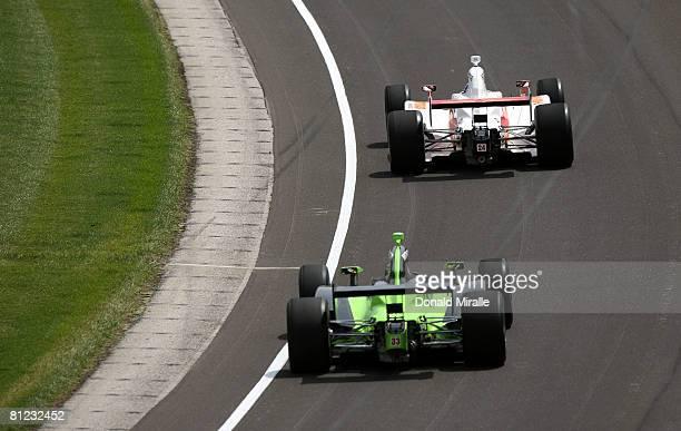 John Andretti driver of the Roth Racing Dallara Honda leads EJ Viso driver of the PDVSA HVM Racing Dallara Honda during the IRL IndyCar Series 92nd...