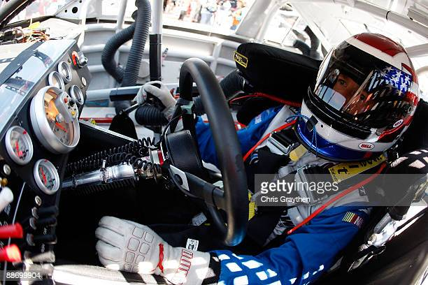 John Andretti driver of the Taco Bell Chevrolet sits in his car during practice for the NASCAR Sprint Cup Series LENOX Industrial Tools 301 at New...