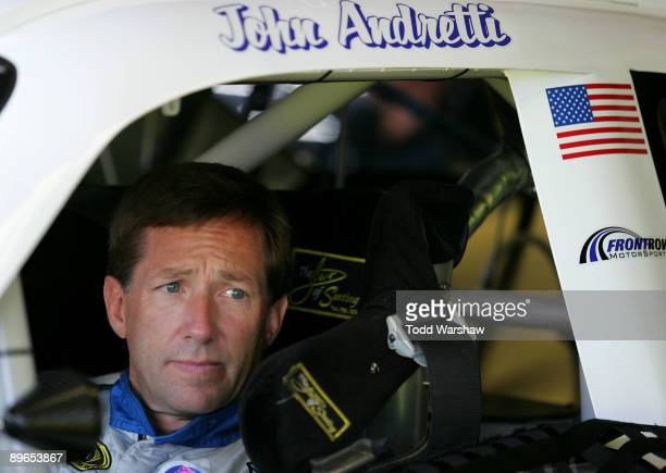 John Andretti driver of the Taco Bell Chevrolet sits in his car prior to practice for the NASCAR Sprint Cup Series Heluva Good Sour Cream Dips at...