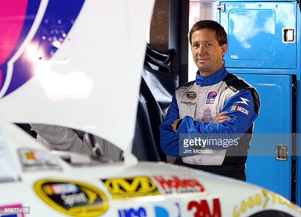 John Andretti driver of the Taco Bell Chevrolet stands in the garage area during practice for the NASCAR Sprint Cup Series Goody's Fast Pain Relief...