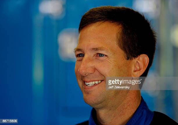 John Andretti driver of the Taco Bell Chevrolet stands in the garage during practice for the NASCAR Sprint Cup Series LENOX Industrial Tools 301 at...