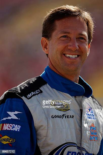 John Andretti driver of the Taco Bell Chevrolet stands on the grid during qualifying for the NASCAR Sprint Cup Series Heluva Good Sour Cream Dips at...