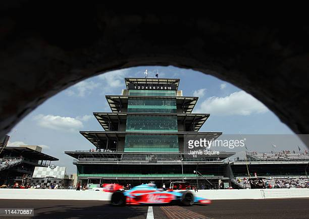 John Andretti driver of the Team Window World Dallara Honda passes the pagoda on the front stretch during practice for the Indianapolis 500 on May 20...