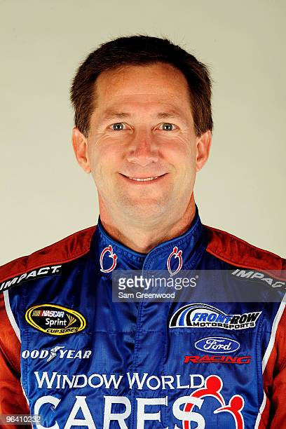John Andretti driver of the Window World Cares Ford poses during NASCAR media day at Daytona International Speedway on February 4 2010 in Daytona...