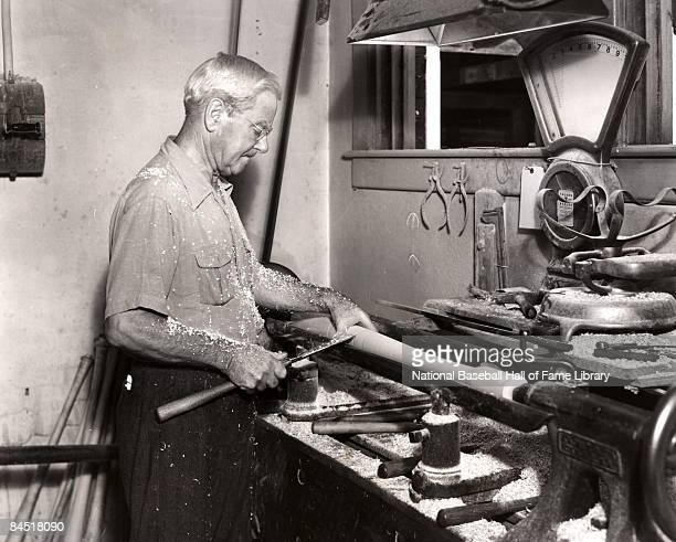 John Andrew Bud Hillerich the creater of the Louisville Slugger makes a bat in the Louisville factory circa 1930's in Louisville Kentucky