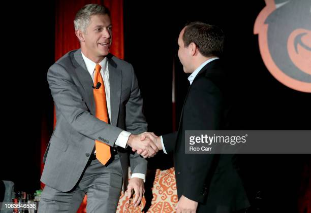 John Angelos of the Baltimore Orioles shakes hands with Mike Elias after introducing him as the as the Orioles Executive Vice President and General...