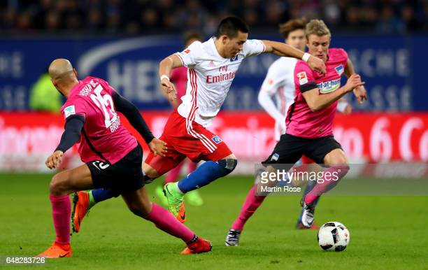 John Anthony Brooks of Berlin challenges Bobby Wood of Hamburg during the Bundesliga match between Hamburger SV and Hertha BSC at Volksparkstadion on...