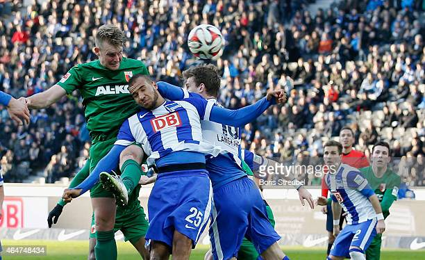 John Anthony Brooks of Berlin jumps for a header with JanIngwer CallsenBracker of Augsburg during the Bundesliga match between Hertha BSC and FC...