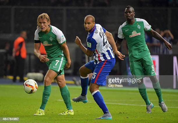 John Anthony Brooks of Hertha BSC passes the ball against Jannik Vestergaard and Assani Lukimya of Werder Bremen during the game between Hertha BSC...