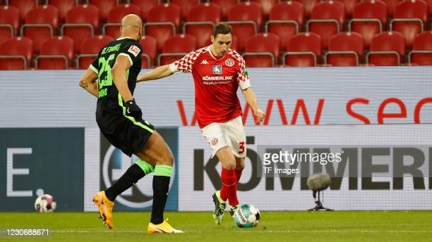 John Anthony Brooks of VfL Wolfsburg and Dominik Kohr of 1. FSV Mainz 05 during the Bundesliga match between 1. FSV Mainz 05 and VfL Wolfsburg at...