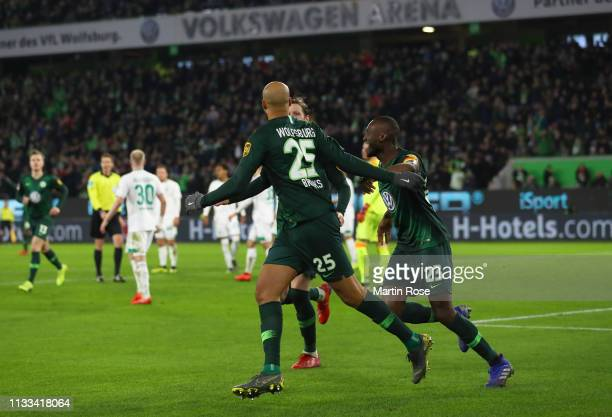 John Anthony Brooks of VfL Wolfsburg celebrates after scoring his team's first goal with team mates during the Bundesliga match between VfL Wolfsburg...