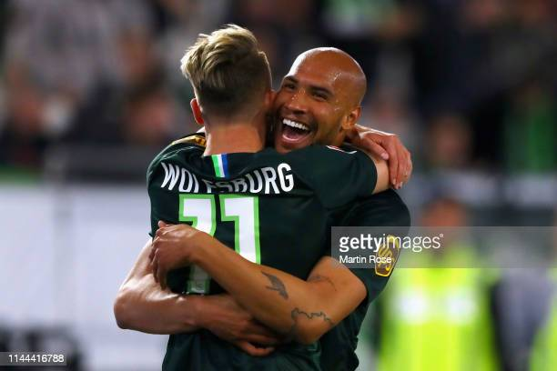 John Anthony Brooks of VfL Wolfsburg celebrates scoring his teams first goal of the game with team mate Felix Klaus during the Bundesliga match...